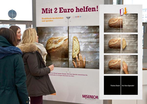 Eine Kreditkarte, ein interaktives Plakat, zwei Euro – Was hat es damit auf sich?
